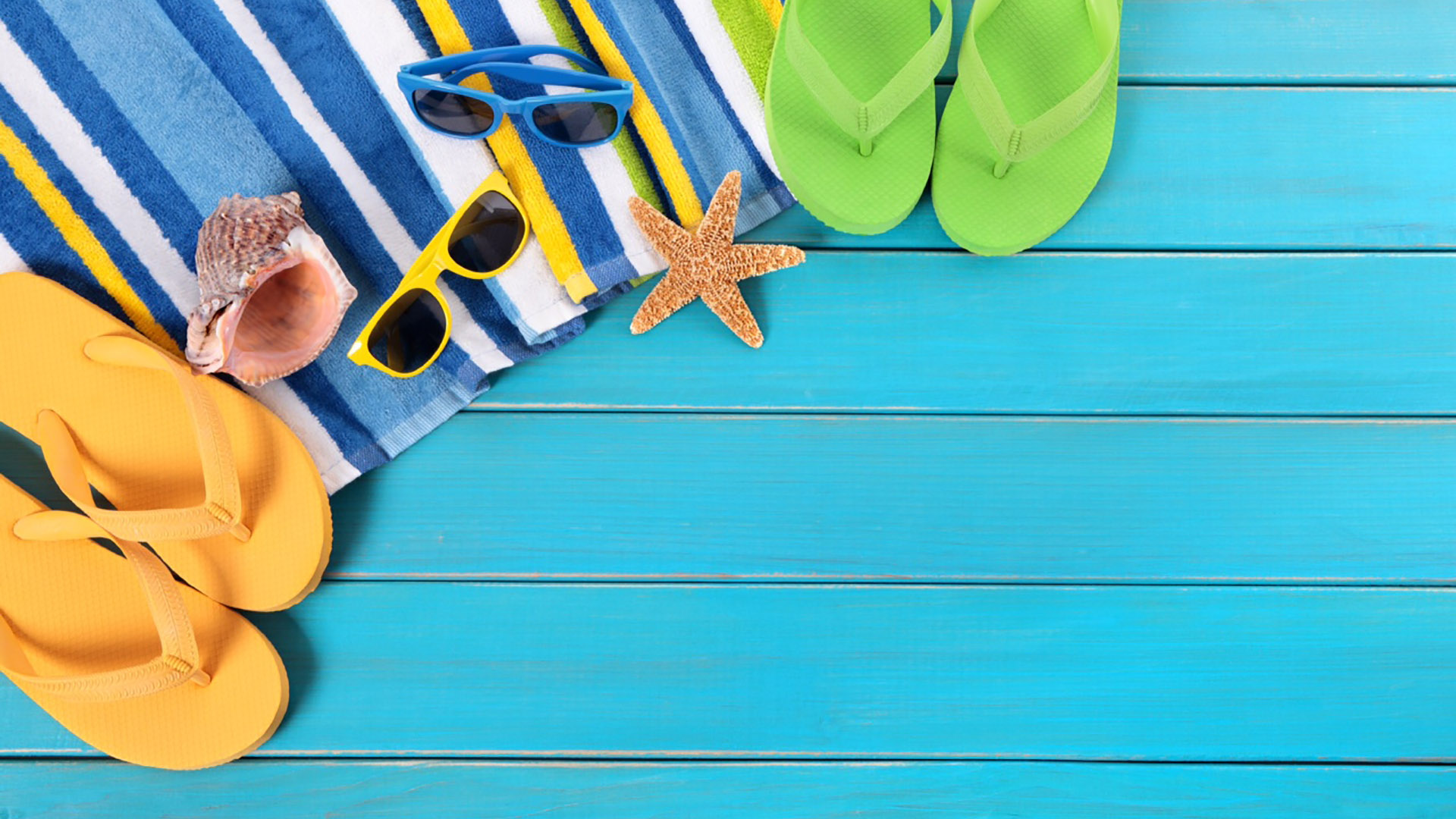 Summer Time Background Beach Towel and Sandals On Blue Dock Wood
